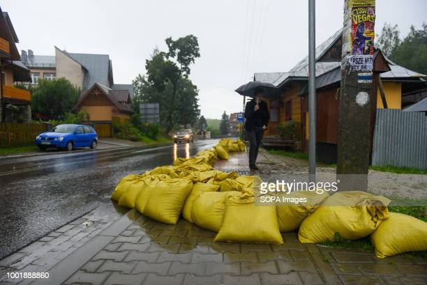 Sand bags seen next to a road in Trybsz Southern Poland and northern Slovakia on flood alert due to extreme rain falls