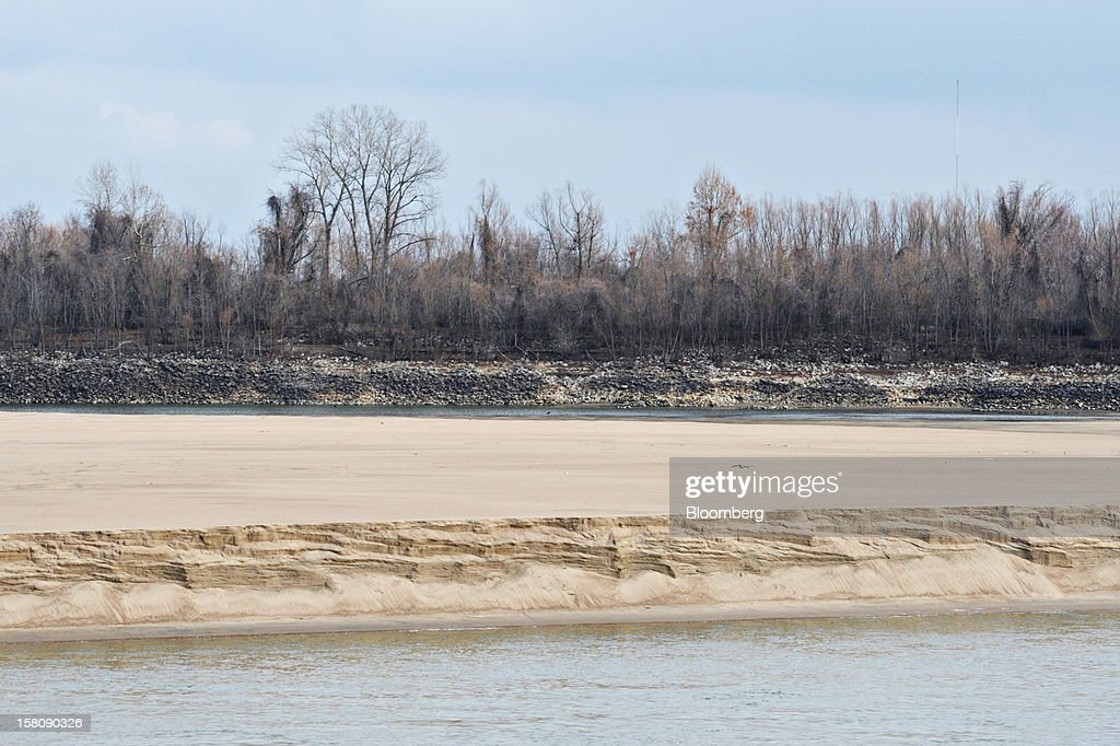 A sand bar exposed by low water appears in front of the normal shoreline of the Mississippi River south of St. Louis, Missouri, U.S., on Friday, Dec. 7, 2012. Barges carrying grain, soybeans, coal, oil and other commodities on the Mississippi River have started to reduce their loads to navigate waters shrunk by the worst drought in 50 years. Photographer: Daniel Acker/Bloomberg via Getty Images