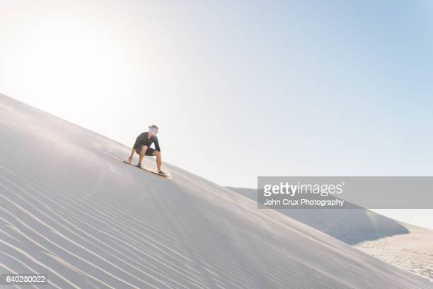 sand boarder in lancelin - travel destinations stock pictures, royalty-free photos & images