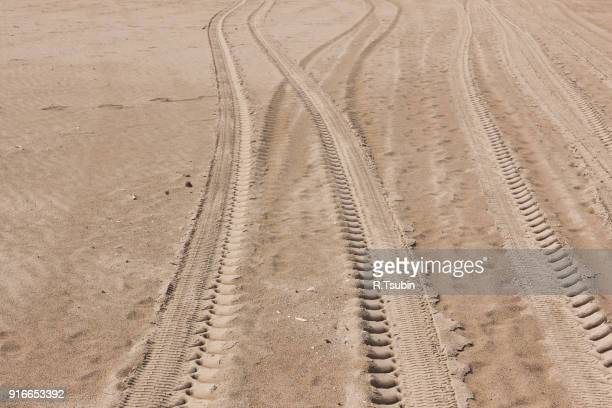 sand car tire tracks - track imprint stock photos and pictures