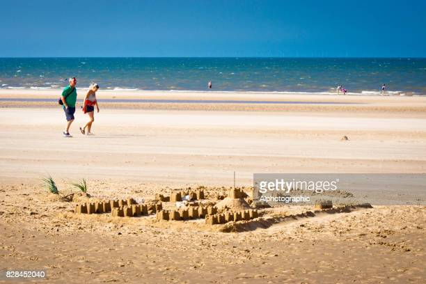 sand castles at dusk - male erection stock pictures, royalty-free photos & images