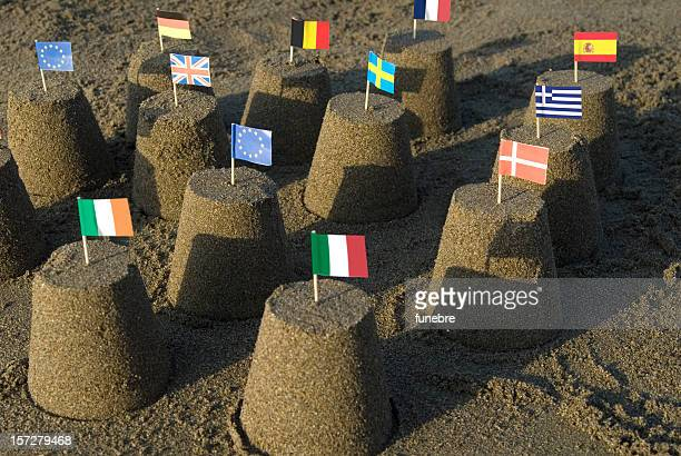 Sand castles with tooth pick flags of the European Union