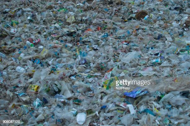 Sand covered garbage that flows from the sea on January 17 2018 at Kedonganan beach Bali Indonesia