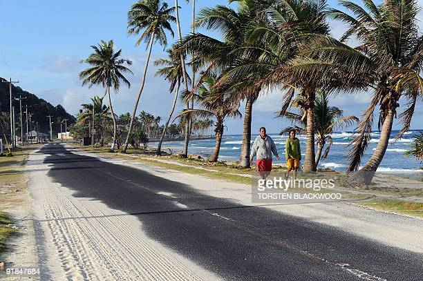 Sand covers much of the only road leading to Tula on the east coast of Tutuila in American Samoa on October 2 2009 Traditional Samoan villages line...