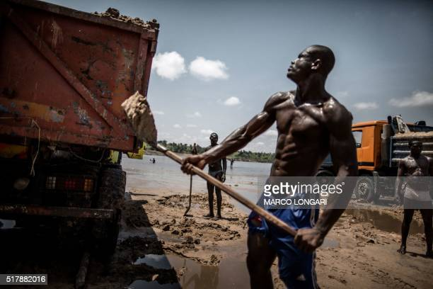 Sand diggers are seen loading trucks at a quarry on the banks of the Congo river in the Kombe district of Brazzaville on March 28 2016 LONGARI