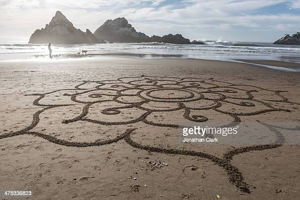Sand drawing on a beach