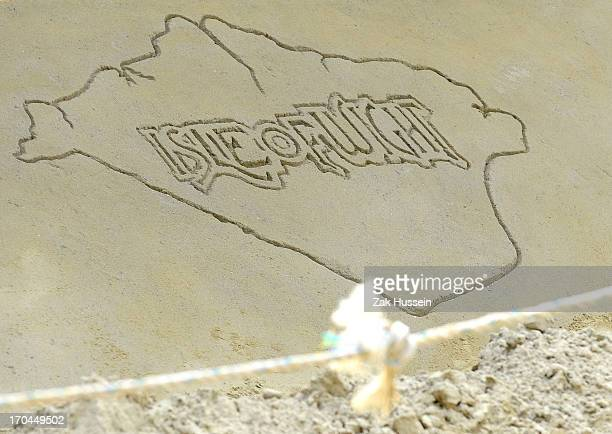 A sand drawing on day 1 of the Isle of Wight Festival at Seaclose Park on June 13 2013 in Newport Isle of Wight