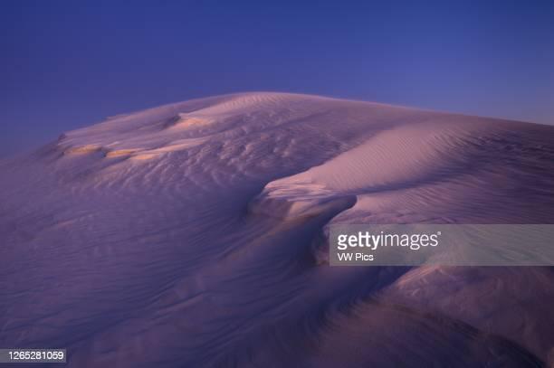 Sand dune at dusk; White Sands National Park, New Mexico, USA.