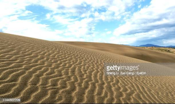 sand dune in desert against sky - land feature stock pictures, royalty-free photos & images