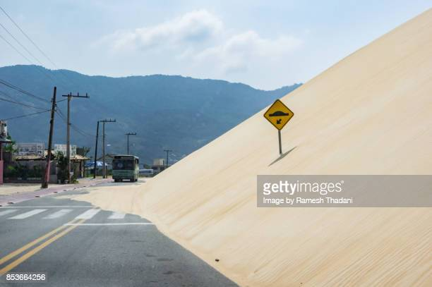 Sand Dune invading the Road