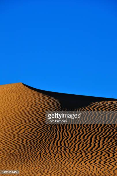 sand dune peak - brosnan stock photos and pictures