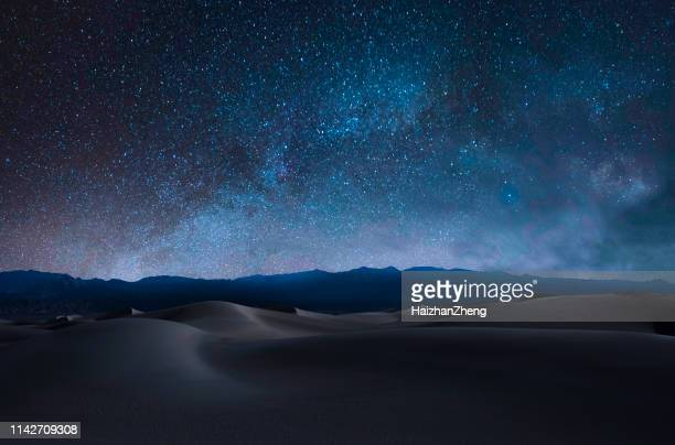 sand dunes and mountains - desert stock pictures, royalty-free photos & images