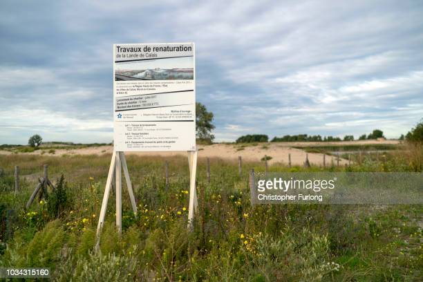 Sand dunes and nature take back the entrance to the infamous Calais Jungle migrant camp as the area is now a nature reserve on September 10 2018 in...