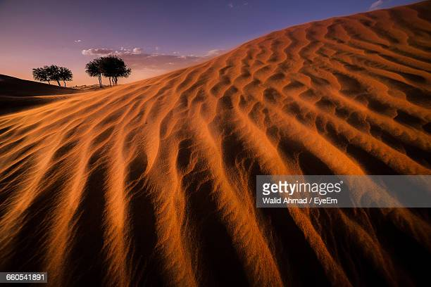 Sand Dunes At Desert During Dusk