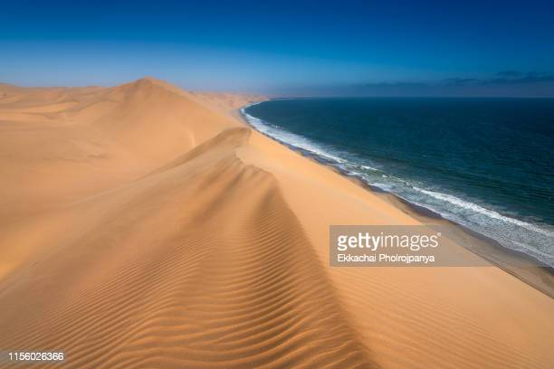 sand dunes at naukluft park in namibia - dead vlei namibia stock pictures, royalty-free photos & images