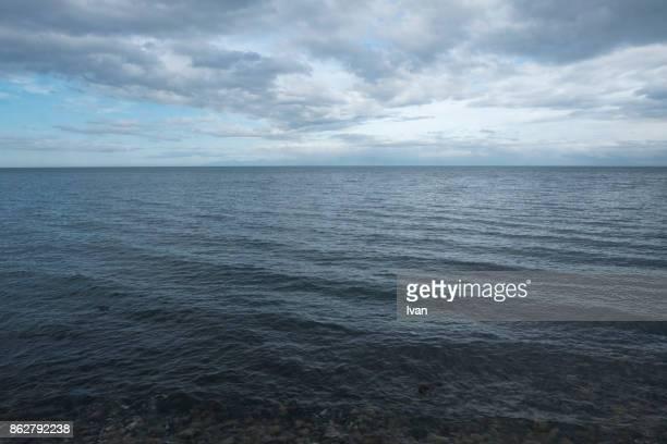 sand dunes by coast line - vista marina fotografías e imágenes de stock