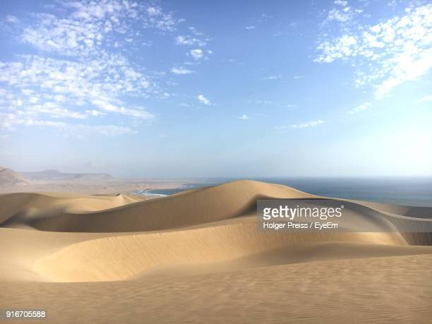 sand dunes in a desert - pisco peru stock photos and pictures
