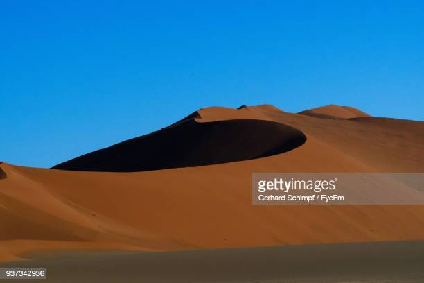 sand dunes in a desert - gerhard schimpf stock photos and pictures