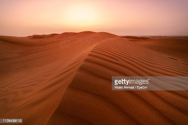 sand dunes in desert against sky during sunset - emirate of sharjah stock pictures, royalty-free photos & images