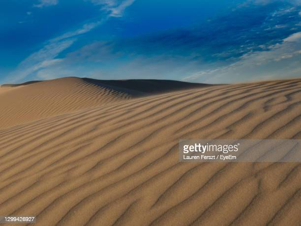 sand dunes in desert against sky - pismo beach stock pictures, royalty-free photos & images
