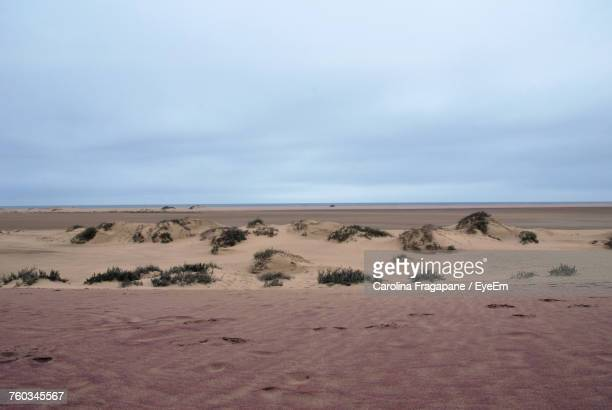 sand dunes in desert against sky - carolina fragapane stock pictures, royalty-free photos & images