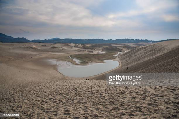 sand dunes in desert against sky - tottori prefecture stock photos and pictures