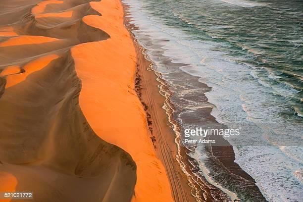sand dunes in namib desert along the coast of namibia - namibia fotografías e imágenes de stock