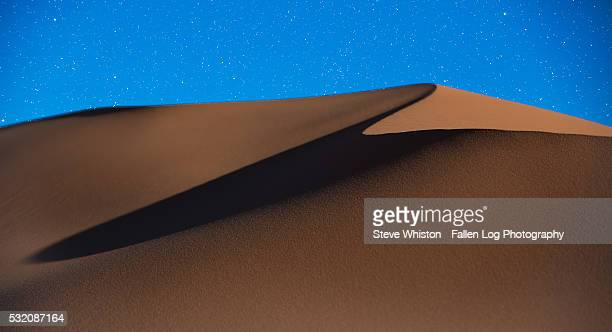 Sand Dunes with Deep Blue Sky and Stars