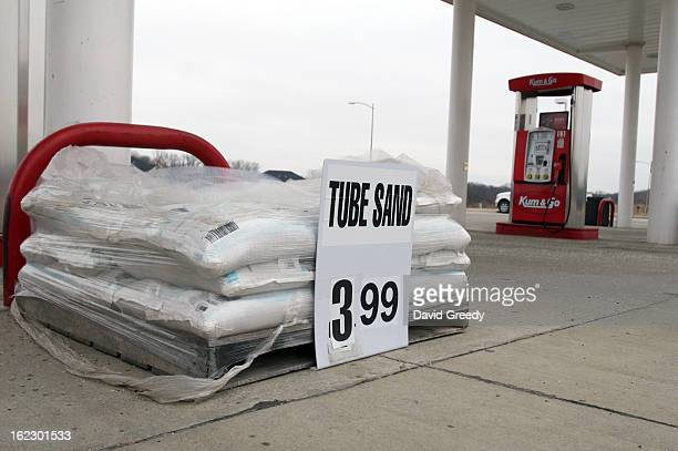 Sand for vehicles is sold at a gas station near Interstate 80 in preparation for up to 9 inches of snowfall on February 22 2013 in Tiffin Iowa Dozens...