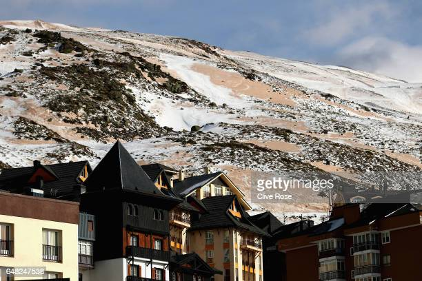 Sand from the Sahara desert which was carried by a recent storm is seen in the discoloured snow on the hills overlooking the resort ahead of the FIS...