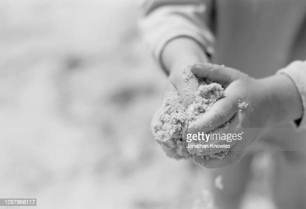sand in hands of child - 1999 stock pictures, royalty-free photos & images