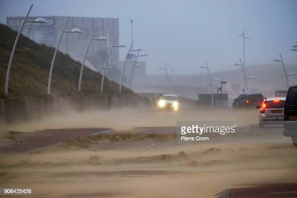 Sand is blown on the road as a hurricaneforce storm blows galewinds up to force 12 in The Hague on January 18 2018 in The Hague Netherlands The Dutch...