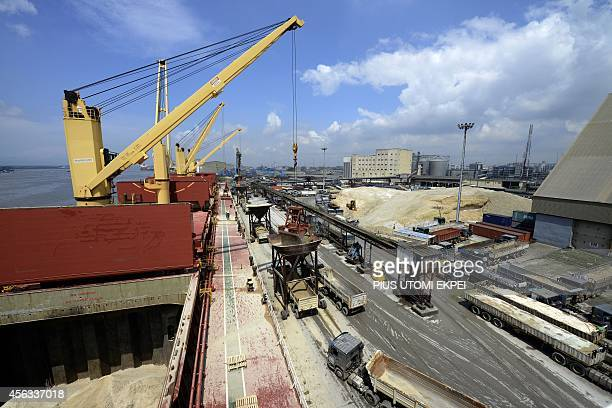 Sand is off loaded from the vast hold of the MV Pintail cargo ship into waiting trucks at the port of Apapa in Nigeria's financial capital in Lagos...