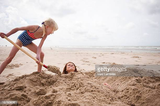 sand mermaid making - enterrar imagens e fotografias de stock