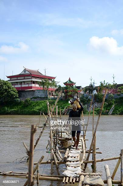 Sand miners use a bamboo bridge to facilitate diving in the middle of the Brantas River Every day they can earn around 5 USD 10 USD The Brantas River...