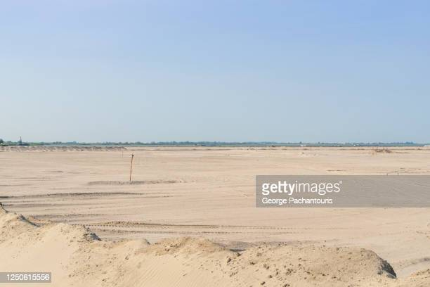 sand on reclaimed land being built in amsterdam, holland - demography stock pictures, royalty-free photos & images
