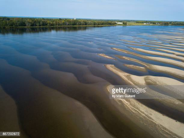 sand patterns beneath the saint john river, new brunswick, canada - freshwater stock pictures, royalty-free photos & images