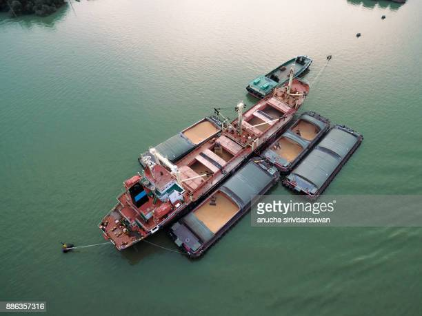sand scoop boat with crane put in a sand boat , water transport, - barge stock photos and pictures
