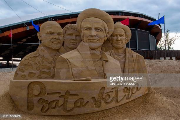 A sand sculptue titled Brainstorm by artists Inese Valtere and Donatas Mockus depicting members of Latvia's most popular band is pictured at the Sand...