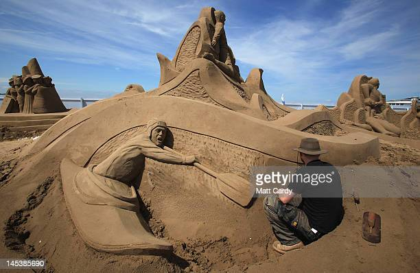 Sand sculpture artist Jamie Wardley completes a sporting greats themed sand sculpture he has created at the annual WestonsuperMare Sand Sculpture...