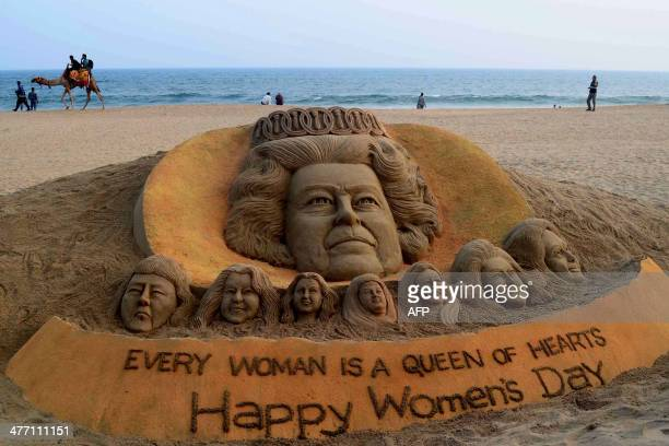 A sand sculpture bearing portraits of women including Britain's Queen Elizabeth II made by sand artist Sudersan Pattnaik is pictured at at Puri beach...