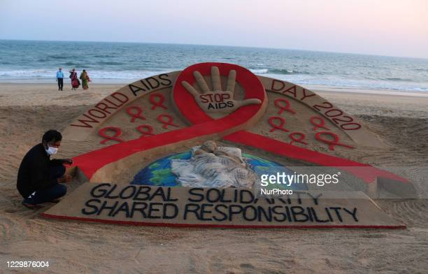 Sand sculpture is seen at the Bay of Bengal Sea's eastern coast beach at Puri, as it is creating by Indian sand artist Sudarshan Pattnaik for public...