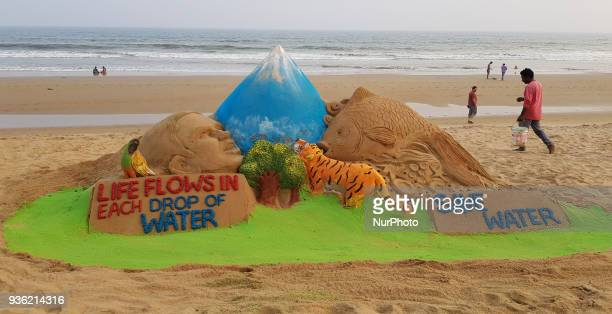 A sand sculpture is seen at the Bay of Bengal Sea's eastern coast beach at Puri as it is creating by sand artist Manas Sahoo for visitors awareness...