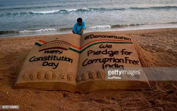 Sand sculpture looks at the Bay of Bengal Sea's eastern coast beach at Puri, creating by sand artist Sudarshan Pattnaik about the Demonetisation in...