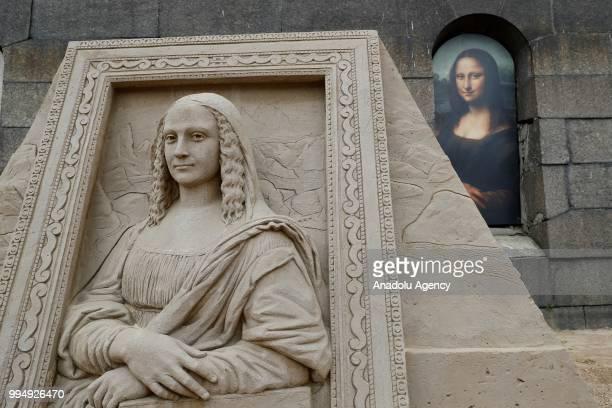 A sand sculpture of Leonardo Da Vinci's Mona Lisa is seen along the Neva River in Saint Petersburg Russia on July 09 2018