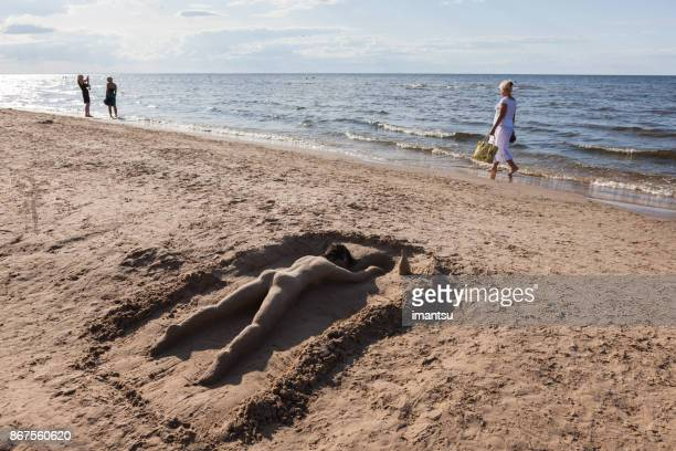 Sable de sculpture sur la plage de Jurmala