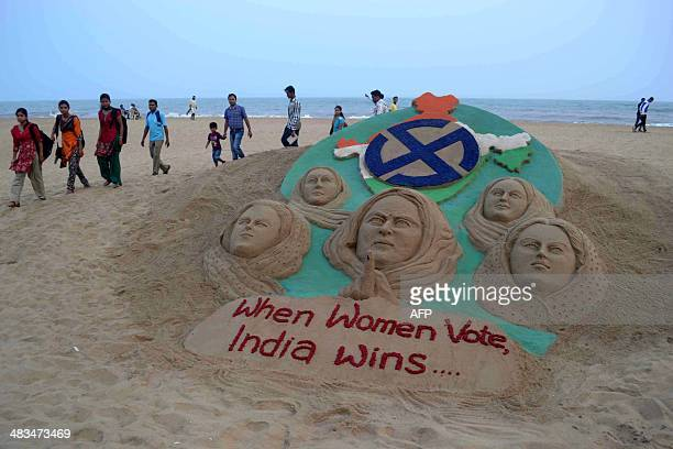 Sand sculpture urging citizens to vote with the message 'when women vote, India wins' is displayed to create voter awareness at Puri beach, some 65...