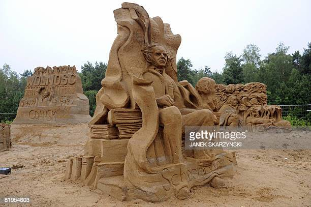Sand sculptures of representing Gdansk citizens philisopher Arthur Schopenhauer and former Polish President Lech Walesa are pictured on a beach in...