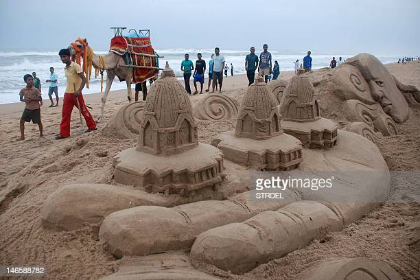 Sand sculptures representing chariots of Hindu deities made my sand artist sudarshan pattnaik are pictured on the Beach on the eve of the annual...