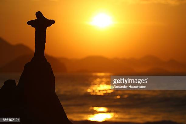 A sand scultpure of the Christ the Redeemer is seen before the Men's Road Race on Day 1 of the Rio 2016 Olympic Games at the Fort Copacabana on...